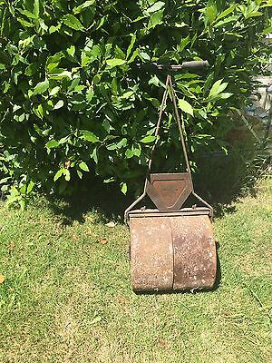 Antique cast iron lawn roller