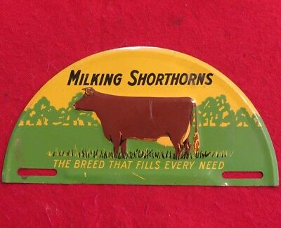 Vintage Embossed Milking Shorthorns Cow Advertising License Plate Topper