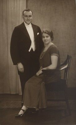 RP PC of lady & gent in evening dress by W Foster Brigham Studios, Bridlington