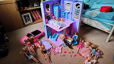 Large Bundle: Barbie Town House, Dolls, Dogs, Clothes And Accessories