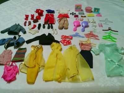 Vintage lot of Barbie/Ken clothing and accessories, some black tags, 60 items