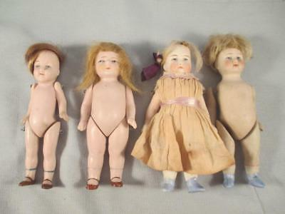 Antique German All Bisque Doll Lot of 4 Painted Eyes Stiff Necks Pegged Limbs