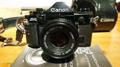 Canon A1 SLR 35mm film camera with Tokina 80-100 zoom and Zeiss F=28mm lens