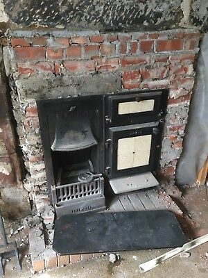 Antique cast iron range with fireplace and oven 1920s /30s