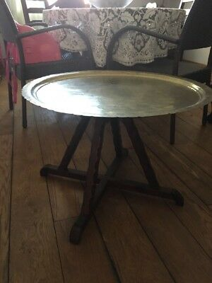 brass topped table with wooden legs