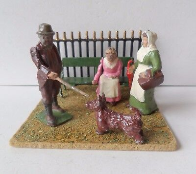BRITAINS PRE-WAR PAINTED LEAD FARMER+FARMERS WIFE+SEATED WOMAN+SEAT+DOG+LAWN Etc