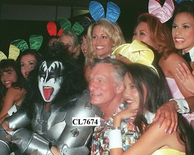 Hugh Hefner with Gene Simmons of Kiss and Playboy Bunnies at the Expo Photo