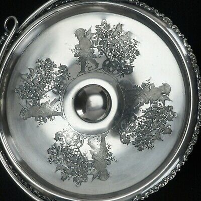 Victorian silver plate cake basket with cupids pulling floral wagons by Wilcox c