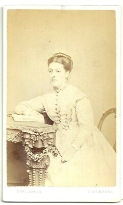 Victorian cdv photo young woman seated at table Liverpool  photographer