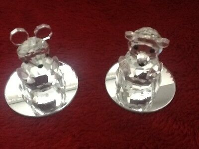 Lead crystal mouse and bear with a mirrored base