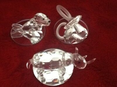 trio of lead crystal ornaments. A dummy, rhino and seal with a mirrored base