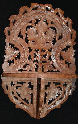 Small, hand carved wooden wall shelf - vine leaves