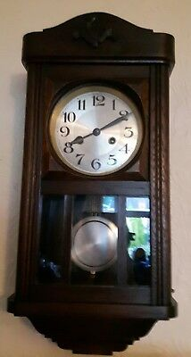 old antique  oak wall clock in great condition