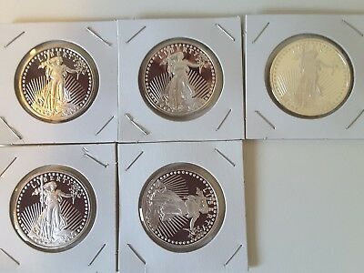 Five 1 oz St. Gauden silver rounds (5 oz silver)