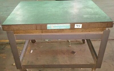 Standridge granite table plate 4ft x 35 3/4in x 6 1/4in ,on stand 33 3/4in tall