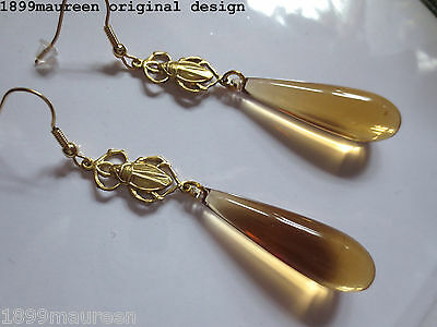 Art Deco earrings Art Nouveau style 1920s 1930s Egyptian Revival amber lucite