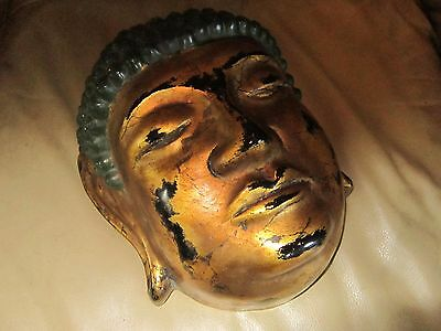 antique asian face mask wall art good condition. Gold lacquered