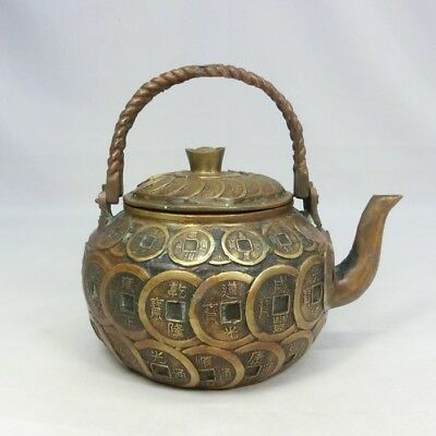 B339: Chinese copper ware water pitcher with old coin design.