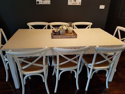 White solid wood dining table with 8 chairs