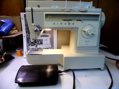 Singer Stylist 533 sewing machine with cover, manual, and foot pedal