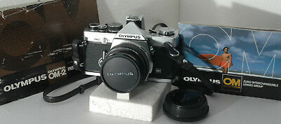 Olympus OM-2n w/ 50mm f1.8 lens, strap, case, batteries, IM; tested; new seals