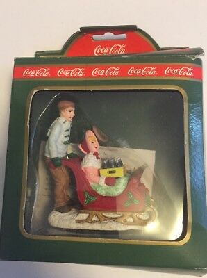 Coca-Cola  Christmas Ornament 64325 Sledders.  New