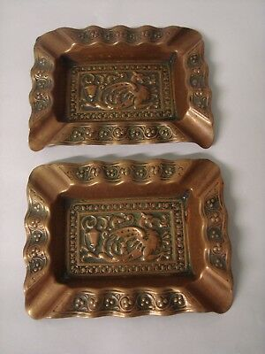 A Pair Of Antique Pressed Brass Decorative Ashtrays, 'wyvern', 'dragon'.