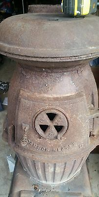 ANTIQUE  Cannon Heater POTBELLY style cannon stove