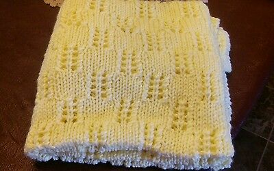 Knitted yellow baby blanket