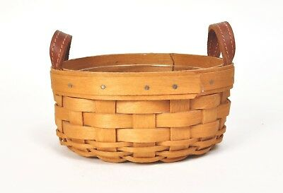 """5"""" Round Longaberger basket with leather handles and plastic protector"""
