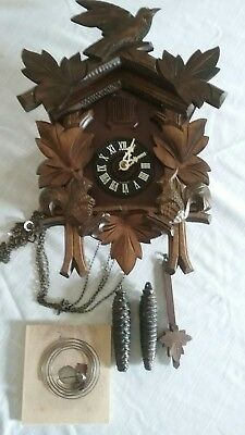 Vintage German cuckoo clock with moving squirrels. Beautiful condition!
