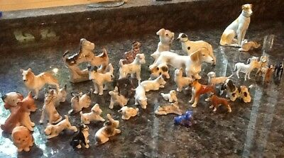 Lot of 39 Vintage Dog Figurines (Made of Various Materials