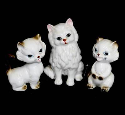 Vintage group of 3 pretty white cat kitten figurines