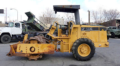 1997 Caterpillar Model CP433C Vibratory Soil Compactor with Front Leveling Blade