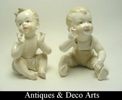 2 Art Deco Ceramic Sitting Piano Baby Figures by Sphinx Maastricht Holland