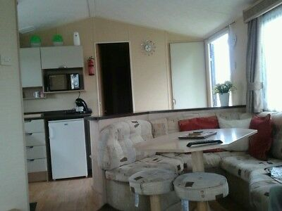 HOLIDAY CARAVAN TO LET 35 x 12ft WITH FULL VERANDA, THREE BEDROOMS