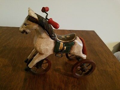 Vintage Wood Composite Carved Painted Horse on Three Wheels with metal parts