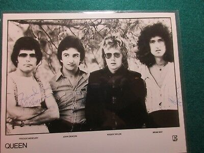 Queen Signed Photo - all four members - blue ball point pen