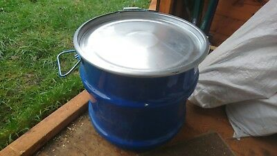 Small steel metal open top drums barrels containers with fastening lids.
