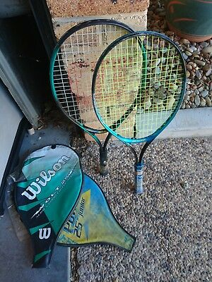 2 tennis racquets and covers