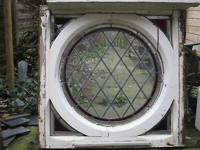 Old circular stained-glass window in frame