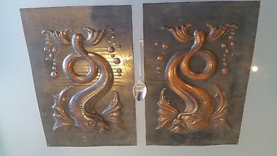 2 INTERESTING METAL PANELS, 30 X 20cm EACH WITH CATFISH MOTIF. MAYBE ART NOUVEAU