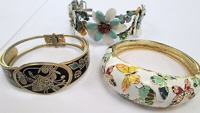 Two vintage gold metal & enamel butterfly design hinged cuff bracelets + 1