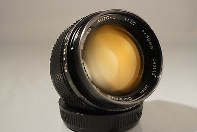 OLYMPUS G. ZUIKO OM 55mm f 1.2 LENS. TOP CONDITION. WITH CASE