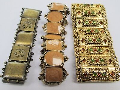 Three attractive vintage gold metal bracelets (enamel, amber paste etc)