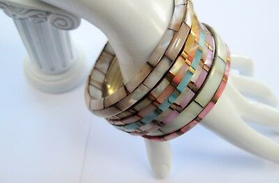 Eight attractive vintage gold metal & mother-of-pearl cuff bracelets + 1