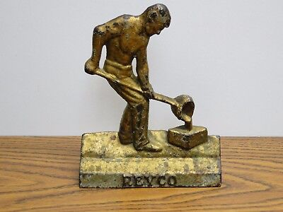 Antique Cast Iron Foundry Worker Doorstop 'REYCO' man pouring mold