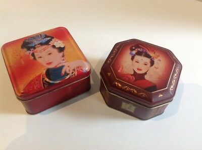 2 x asian themed TINS. moon cake tins(?). approx 5-15 yeras old(?)