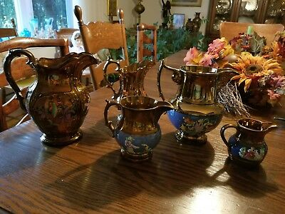 Five Copper Lusterware Pitchers