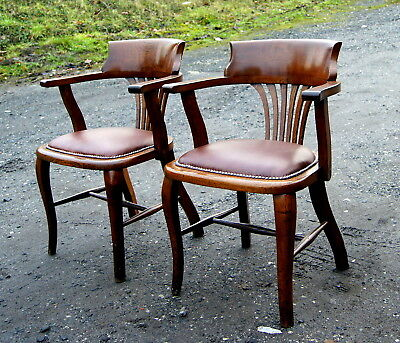 A matched pair of good antique open arm office chairs
